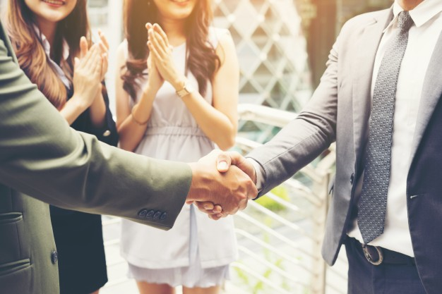 business people shaking hands finishing up a meeting success deal 1150 2552 - 5 Tips You Need to Consider When Looking for a Good Lawyer